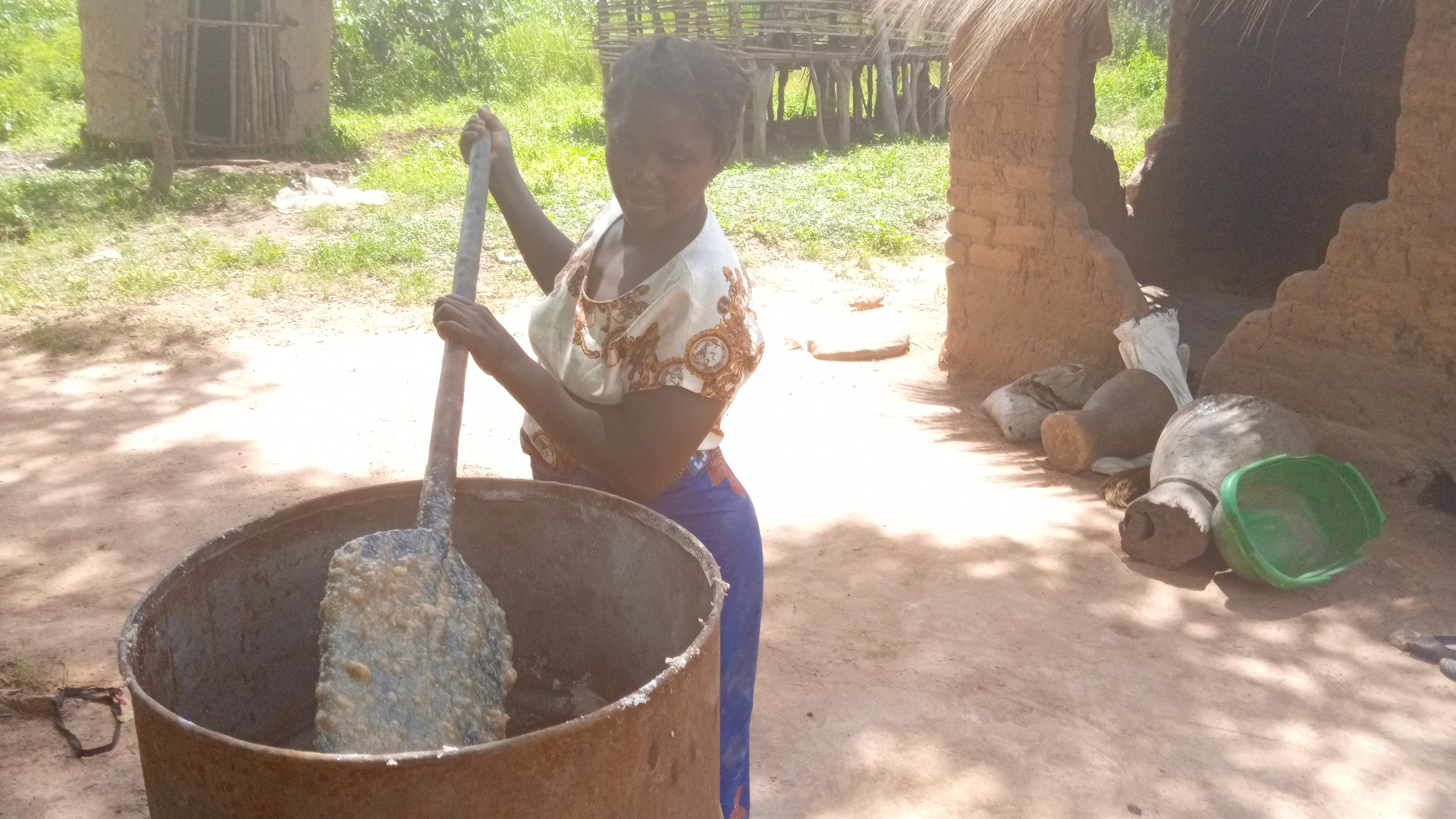 Josephine Kombe brews traditional beer from maize and cassava. Photo: World Agroforestry/Lydia Amanzi